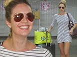 Feeling brave? Model Candice Swanepoel wears a long T-shirt (and nothing else) as she jets into Brazil
