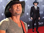Tim McGraw could be slapped with a lawsuit as female fan 'he hit at concert for grabbing his leg' hires personal injury lawyer