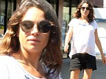 Pregnant Mila Kunic dresses baby bump in loose fitting blouse teamed with tiny black shorts