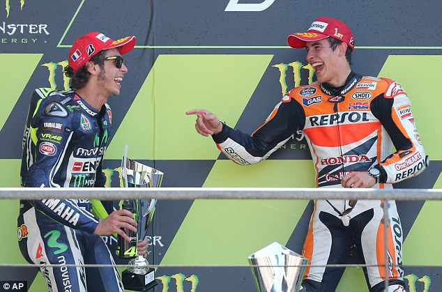 Got you!: Spain's Marquez (right) caught Italy's Rossi (left) with 15 laps remaining and held on for victory