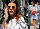 Alexa Chung was spotted strutting around New York City on Friday with a pair of ballet slippers around her neck to match her spindly dancer-like legs. The 30-year-old television presenter and model showcased her super thin frame in a horizontally-striped nautical-inspired dress while running errands.