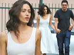 Still going strong: Emmy Rossum holds hands with boyfriend Sam Esmail on Shameless set in rare snap together