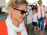 Orange you impressed I'm this fit at 56? Sharon Stone stand out at airport with son in bright top and matching shoes