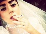 The puffing bride! Lady Gaga smokes a cigarette while wearing white lace wedding dress and veil as she jets off to Tokyo