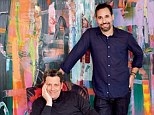 Behind the scenes! Designer Isaac Mizrahi (seated) and his husband Arnold Germer in their den. The painting behind them is by Tomory Dodge