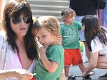 Doting mom: Selma Blair helped her three-year-old son Arthur put on and tie his shoes at the farmer's market in Los Angeles on Sunday