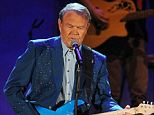 Remarkable: Pictured here in 2012 during the farewell tour he bravely gave following an Alzheimer's diagnosis, Rhinestone Cowboy Glen Campbell is now in a full-time care facility. A documentary of his remarkable final performances will be released in October