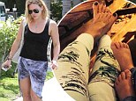 Hilary Duff shows off her legs in wrap skirt... after placing her manicured feet next to son Luca's for cute Instagram snap