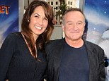 Robin Williams' wife Susan Schneider breaks silence as she says she's 'utterly heartbroken' at losing 'my husband and my best friend'