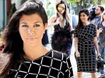 Pregnant Kourtney Kardashian displays growing bump in chic monochromatic dress while out to lunch with sister Khloe in the Hamptons