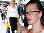 Specs appeal! Milla Jovovich is every inch the stylish jet-setter as she breezes through LAX in effortlessly chic ensemble