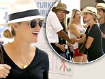 Girls weekend? Reese Witherspoon spotted wearing Panama hat at LA airport as she heads out of town with gal pals... and there are no kids in sight