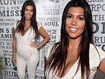 Embracing the lace! Pregnant Kourtney Kardashian makes brave fashion choice as she hits red carpet in plunging tight white jumpsuit