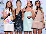 Quick change artist Sarah Hyland shows off her incredible style as she wears FOUR outfits while hosting Teen Choice Awards