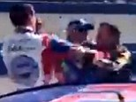 Fight: In another incident, Stewart (right) approached and punched fellow racer Joey Logano