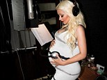 Music to her ears! Christina Aguilera gives her unborn baby a listen to her music in a twitter snap writing, 'baby girl getting first listen to what mama's been creating in the studio'