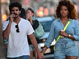 Her milkshake still brings all the boys to the yard! Singer Kelis strolls hand-in-hand with hunky new mystery man
