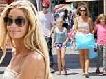 The Pilates has paid off! Denise Richards displays toned legs in playsuit as she shops with daughters Lola and Sam