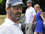Jon Hamm ditches the Mad Men glamour for scruffy beard and geek specs on Central Park stroll with girlfriend Jennifer Westfeldt