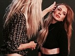Lindsay Lohan flashes midriff in a revealing black long-sleeve as she gets glammed up for a photo shoot