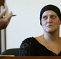 Tanya Singleton sits on the witness stand as her lawyer E. Peter Parker speaks during a hearing in Fall River Superior Court in Fall River, Mass., Tuesday, A...