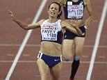 Britain's Jo Pavey crosses the line to win the gold medal in the women's 10,000m final during the European Athletics Championships in Zurich, Switzerland, Tuesday, Aug. 12, 2014. (AP Photo/Martin Meissner)