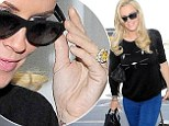 Jenny McCarthy gives everyone a good view of her huge engagement ring as she jets out of LAX