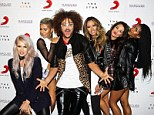 Party rocker: Redfoo posed it up with girl group G.R.L at Marquee nightclub in Sydney on Tuesday