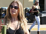 Liquid lunch time! LeAnn Rimes squeezes into a pair of tight white jeans on healthy juice and grocery run