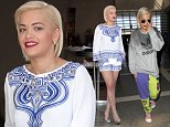 12 Aug 2014 - LOS ANGELES - USA  RITA ORA WALKS THROUGH LAX WEARING HER PJ'S AND A BIG SMILE. BYLINE MUST READ : XPOSUREPHOTOS.COM  ***UK CLIENTS - PICTURES CONTAINING CHILDREN PLEASE PIXELATE FACE PRIOR TO PUBLICATION ***  **UK CLIENTS MUST CALL PRIOR TO TV OR ONLINE USAGE PLEASE TELEPHONE  44 208 344 2007 ***