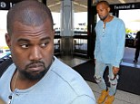 Why so glum? Kanye West looks downcast as he arrives at LAX wearing ripped jeans