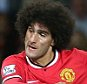 MANCHESTER, ENGLAND - AUGUST 12:  Marouane Fellaini of Manchester United scores their second goal during the Pre Season Friendly match between Manchester United and Valencia at Old Trafford on August 12, 2014 in Manchester, England.  (Photo by Matthew Peters/Man Utd via Getty Images)