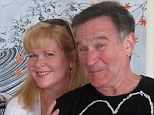 Close friends: Rebecca Erwin Spencer and Robin Williams in this undated picture from the Facebook account of the comedian's personal assistant