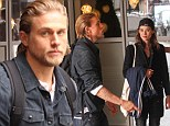 This colours don't wash off! Charlie Hunnam bares his Sons Of Anarchy tattoos as is spotted with Spanish actress Astrid Bergès-Frisbey in London