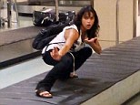 Lost and found: Michelle Rodriguez posted a video of herself posing on the baggage carousel at the airport