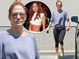 She's still Jenny from the block! Jennifer Lopez bares toned midriff in cropped top and funky work-out attire