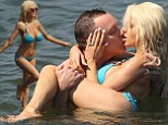 Courtney Stodden is back in a bikini (and Doug Hutchison's arms) as couple frolic on the beach after announcing they're newly engaged nine months after marriage split