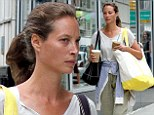 Timeless beauty! Christy Turlington, 45, shows off her flawless skin as she goes make-up free on morning coffee run