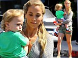 Mama bear! Elizabeth Berkley holds on tight to son Sky as she struts her lean legs across Brentwood streets