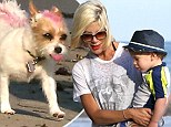 Tori Spelling brings along her pooch with a pink streak dyed on coat as she spends a family day at the beach in Malibu