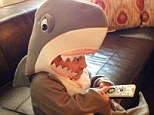 Over-excited: Verne Troyer posted a snapshot of himself in a giant shark costume watching Discovery's popular Shark Week