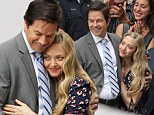 Amanda Seyfried and Mark Wahlberg were spotted getting cozy while filming scenes for their upcoming sequel to 2012 comedy Ted. The 28-year-old actress and her 43-year-old co-star stood with their arms wrapped around each other while on the film's set in Boston, Massachusetts on Tuesday.
