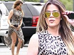 Khloe Kardashian flashes her legs in racy animal print frock while shooting a scene for reality show with sister Kim