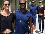 Eddie Murphy cosies up to model girlfriend Paige Butcher as she shows off her toned midriff during romantic stroll