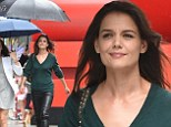 Can't rain on her parade! Katie Holmes defeats the drizzle by enlisting an umbrella squad to keep her chic and dry for screening of The Giver