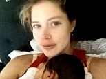 'Best feeling in the world!': Make-up free Doutzen Kroes shares a cute snap cradling newborn daughter Myllena Mae