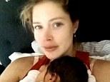 'Best feeling in the world!': Make-up free Doutzen Kroes shares a cute snap cradling newborn daughter Myllena Mae