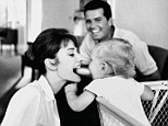Behind-the-scenes: A new book features rarely seen candid photos of Audrey Hepburn from 1953 to 1966. (Pictured: Sean, Audrey's son by Mel Ferrer, plays with his mother while actor James Garner beams)