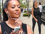 Nothing scary to see here! Mel B flashes her taut midriff in a cropped 'Love & Peace' tank