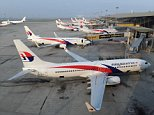 (FILES) This file photo taken on March 30, 2014 shows Malaysia Airlines planes parked at the terminal at Kuala Lumpur Intenational Airport (KLIA) in Sepang. Deeply troubled Malaysia Airlines will be de-listed and taken private ahead of a major restructuring following the twin disasters of MH370 and MH17, under a proposal announced on August 8, 2014 by its majority shareholder.      AFP PHOTO / FILES / ROSLAN RAHMANROSLAN RAHMAN/AFP/Getty Images